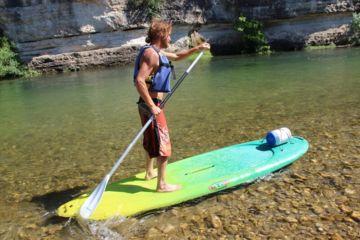 Descentes animées, stand-up paddle